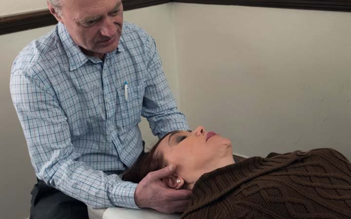 chiropractic adjustment pinched nerve neck NYC