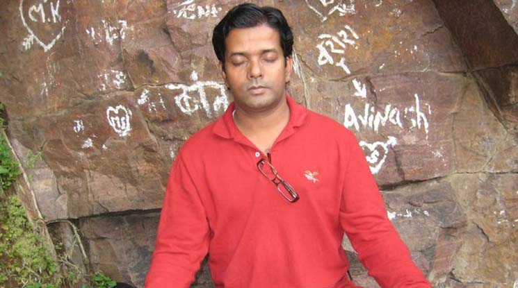 "This is a photo of Vinayak Kaurwar meditating. Vinayak Kaurwar is the author of the recent book, ""Subway Mantras"""